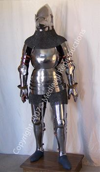 "Full Armour  So called ""Hounskull"" Style  c. 1375  This armour was the first truly full plate armour to be worn during the Middle Ages. This was an international style, predating the German And Italian Schools of armour-making, and would have seen action all over Europe until the first quarter of the fifteenth century. Our harness comes complete with plate sabatons (not shown) and the distinctive ""hourglass"" gauntlets."