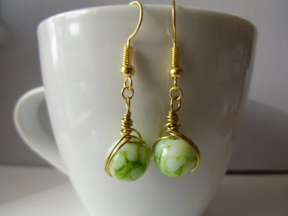 Gold wire wrapped different type earrings