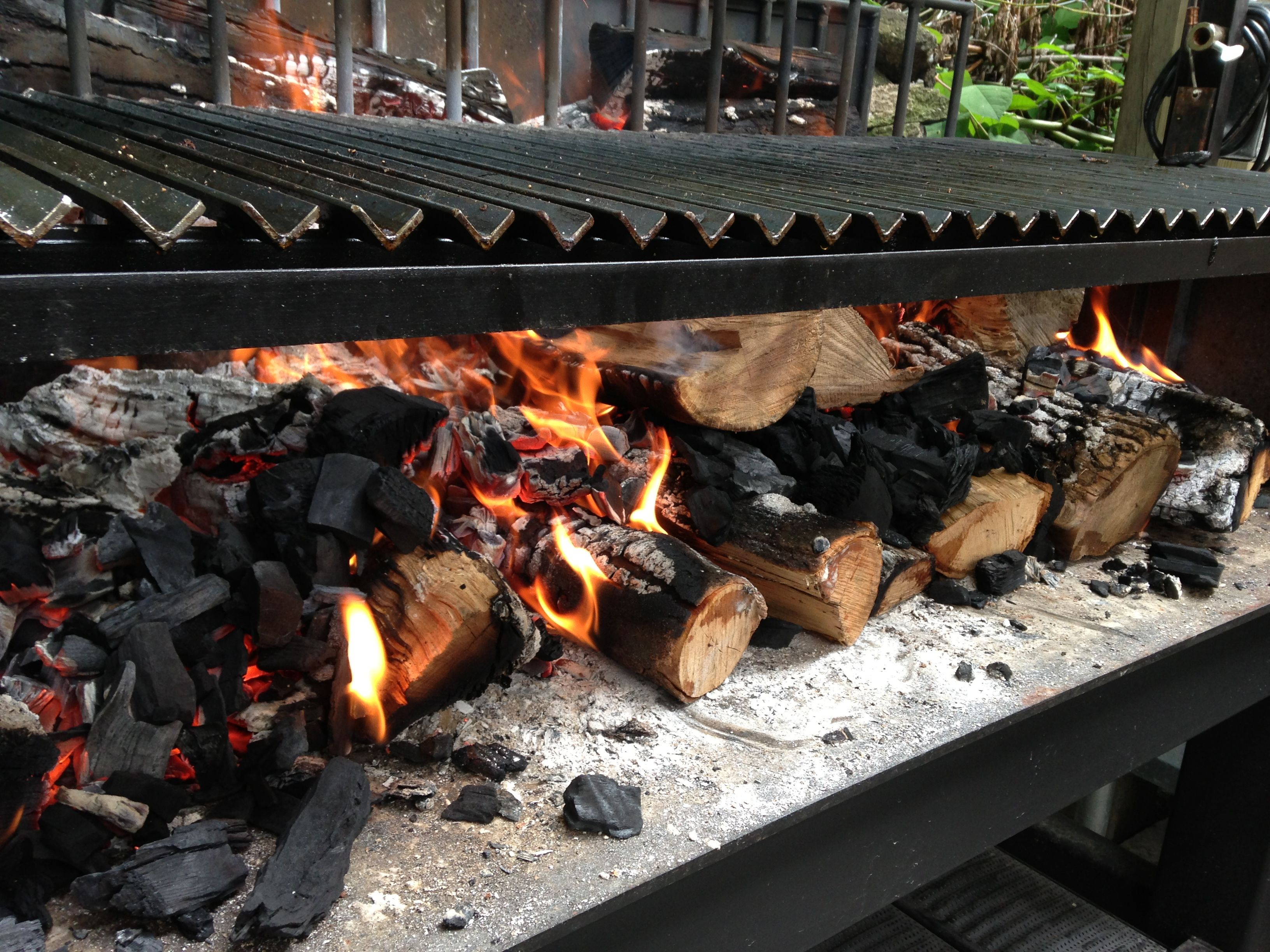 Lighting a big fire on the Argentine Exhibition Grill at The Big Crow in Toronto.