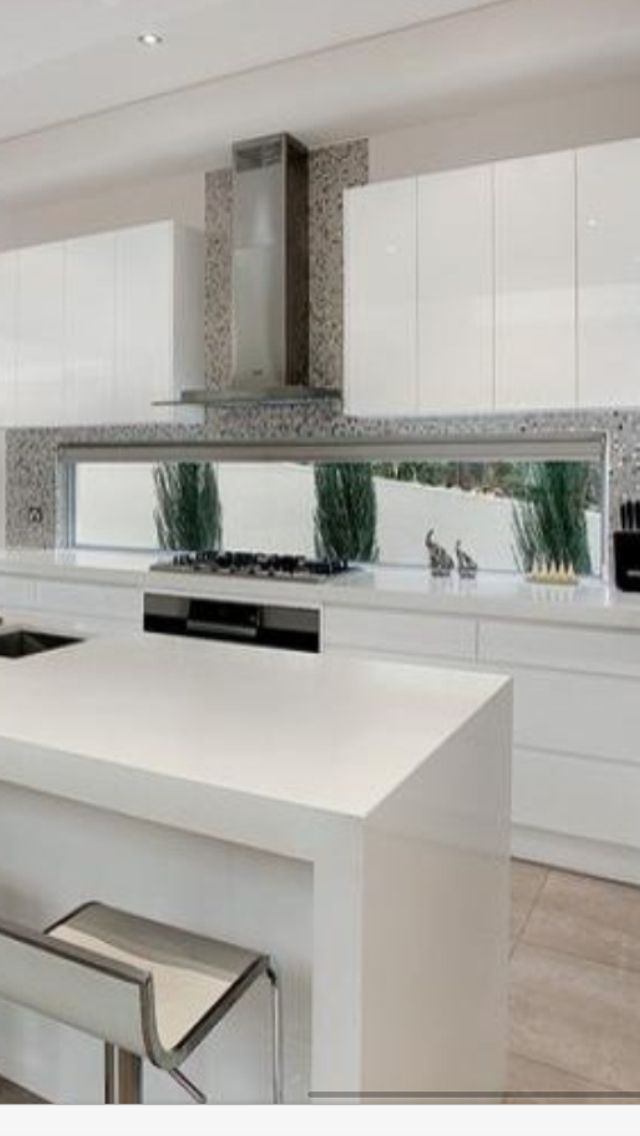 window splashback with tiles and canopy rangehood | kitchen
