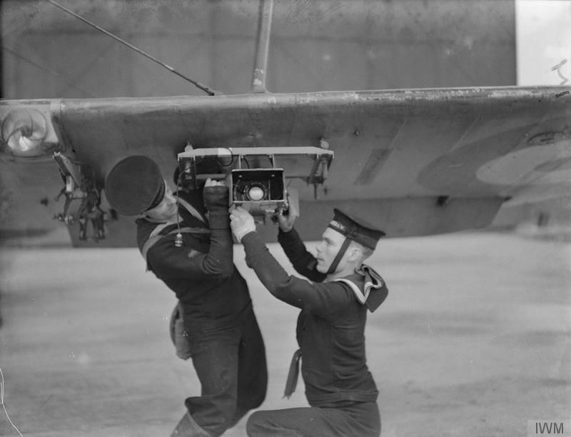 TRAINING OF NAVAL PILOTS FOR NAVAL AIRCRAFT. 1941, HMS JACKDAW, ROYAL NAVAL AIR STATION CRAIL, FIFE.Adjusting the torpedo aiming camera to the wing of the Fairey Swordfish. The camera is used for checking accuracy during practice attacks.