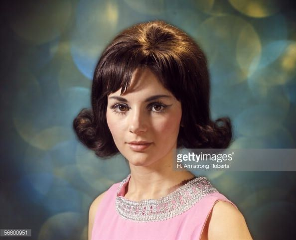 News Photo : Portrait of brunette woman with flip hairstyle.