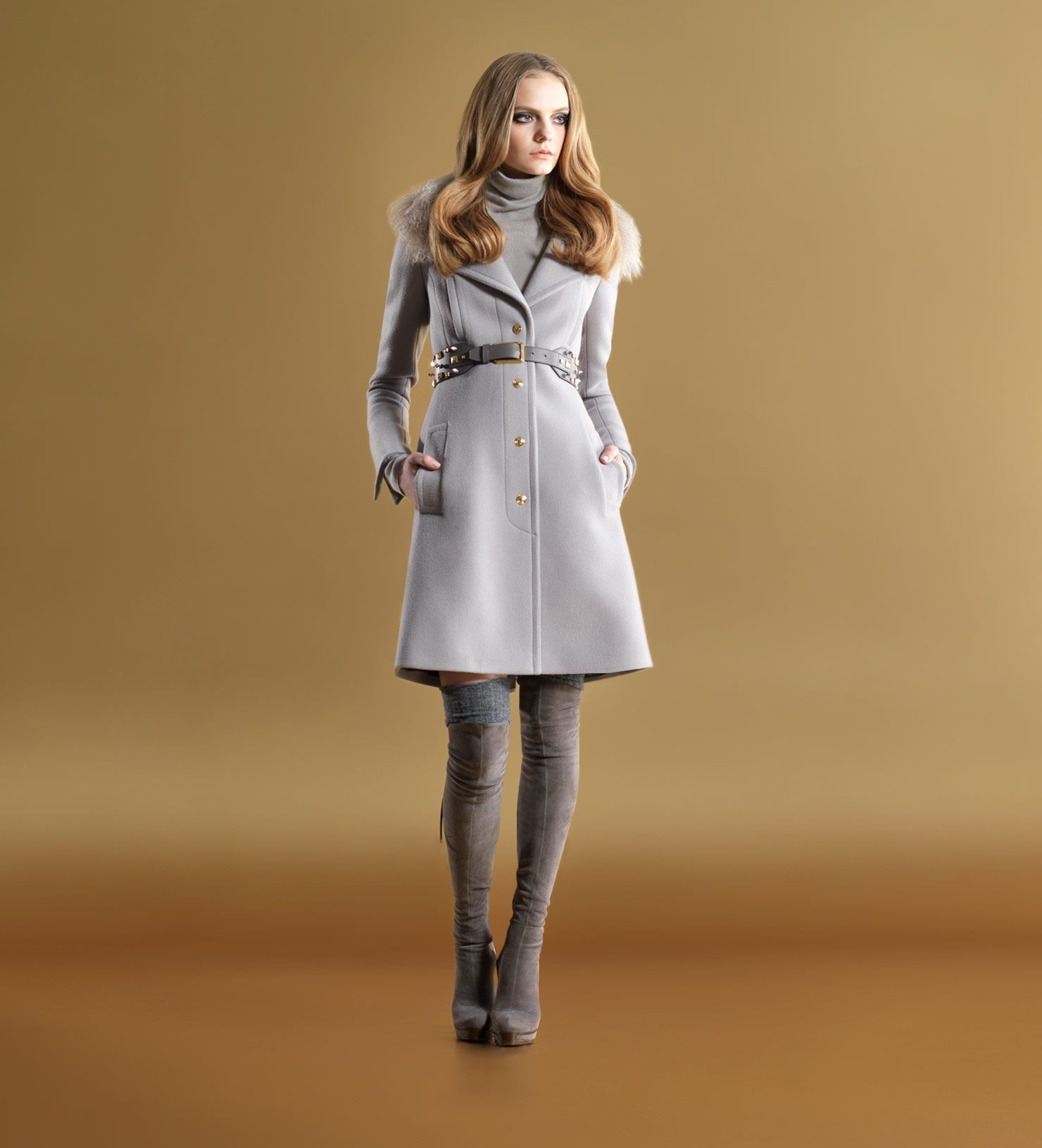 I am a sucker for a good coat.  And starting to dig the over-the-knee boot idea again.