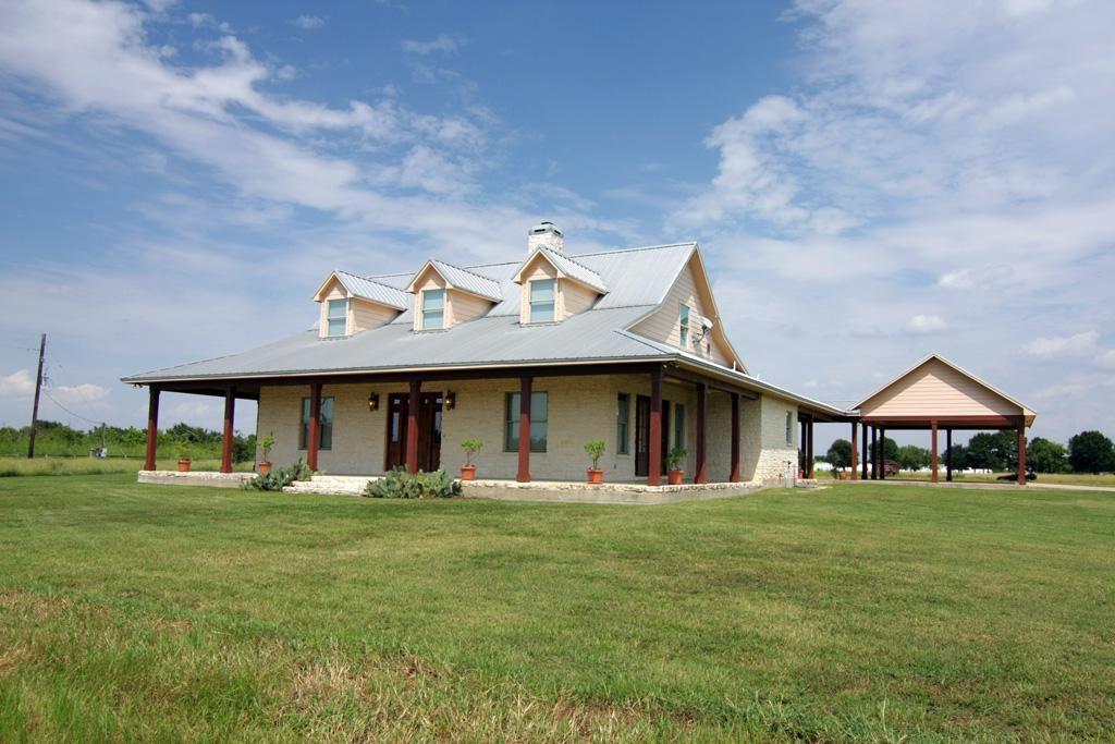 Farmhouse. Metal roof houses
