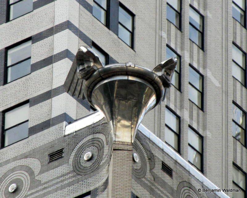 Replica 1929 Chrysler Radiator Caps Adorn The Corner Of The Chrysler Building