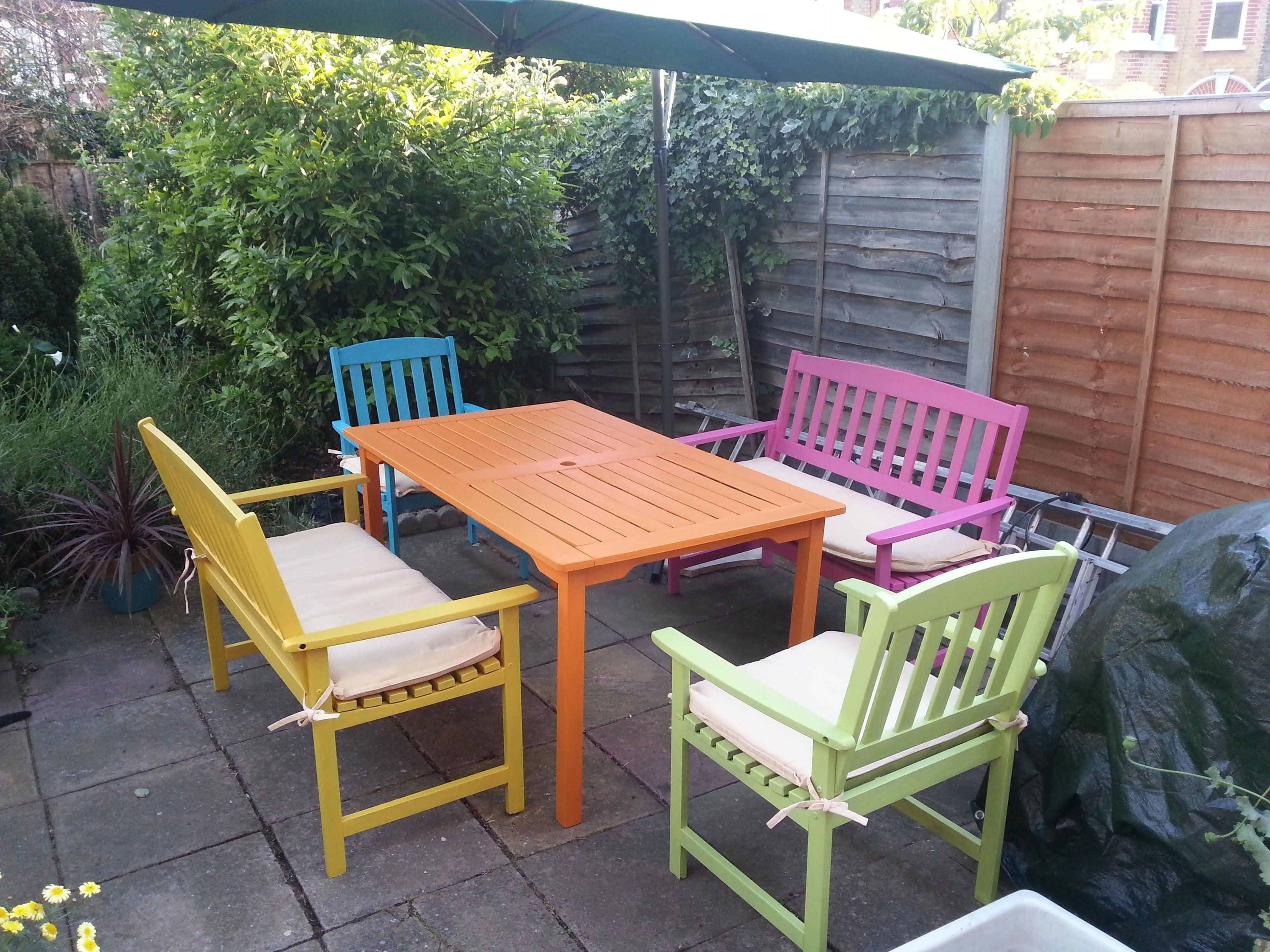 Candy Coloured Garden Suite Sure To Make You Smile Even When The Typical Uk Weather Rear Garden Furniture Uk Painted Garden Furniture Painted Outdoor Furniture