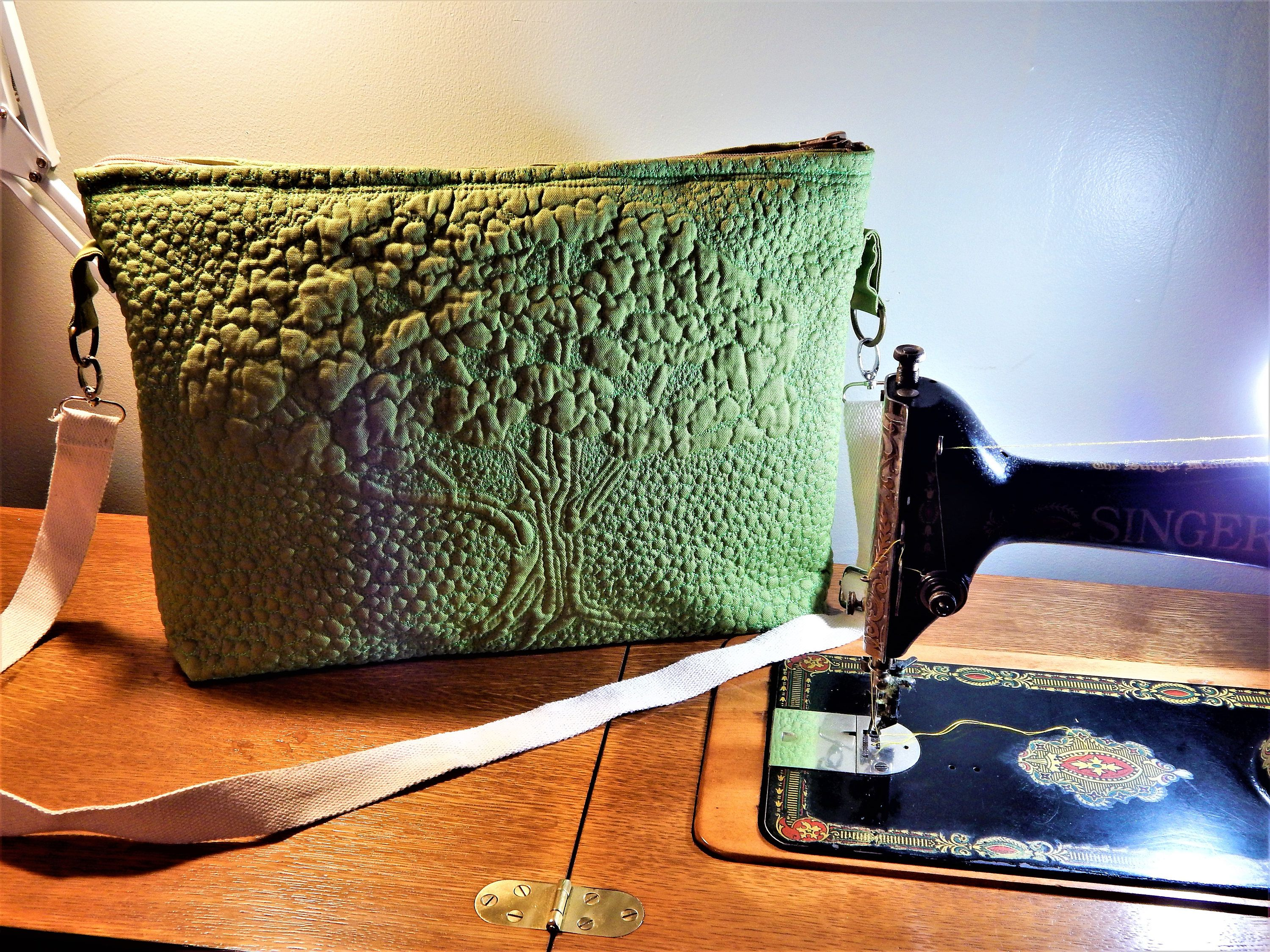 c93b43fdf3 Tree of Life quilted messenger bag