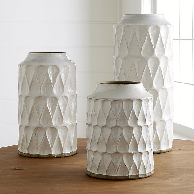 Shop Kora Vases.  Alternating up and down in a great graphic pattern, teardrops texture the Kora vase's white glazed surface.   Painted detail at the bottom and rim adds a bit of contrast to highlight the vase's stately stature and intriguing shape.