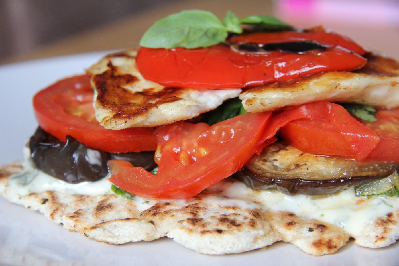 An open sandwich with grilled veggies