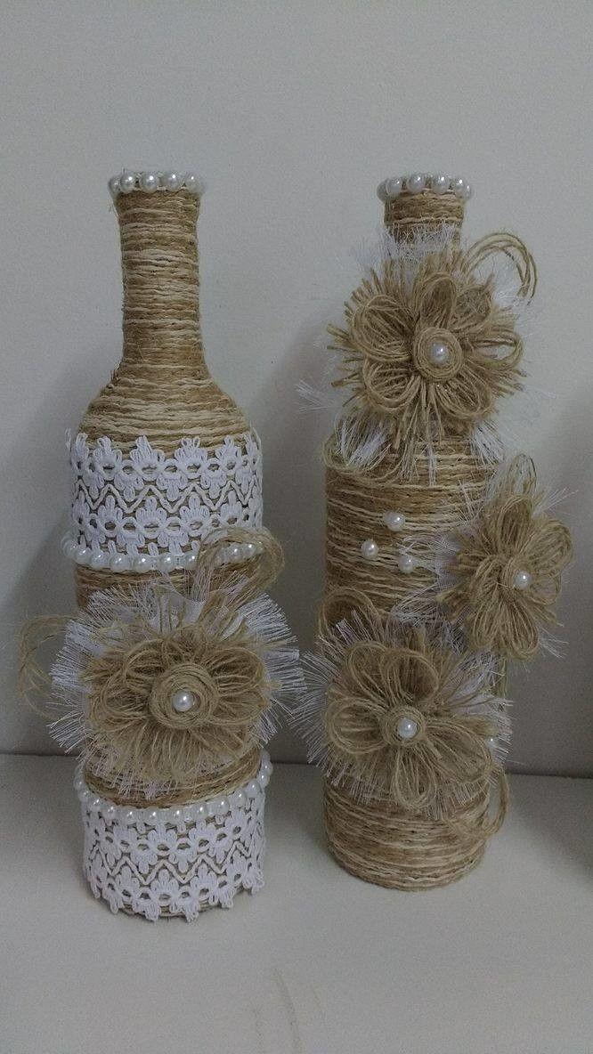 Duo de garrafas decoradas com barbante e