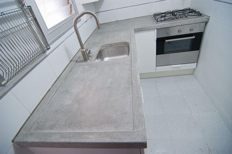 una parte de la encimera est ms baja para secar los platos y limpiar con el grifo extensible superficie pulida y sellada with encimeras de cocina ikea - Encimeras Cocina Ikea