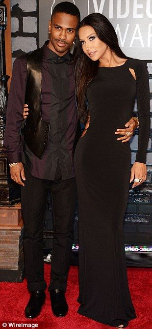 Sleek and sultry: Glee star Naya Rivera looked stunning in a floor length black long sleeved number as she arrived with her rapper boyfriend Big Sean
