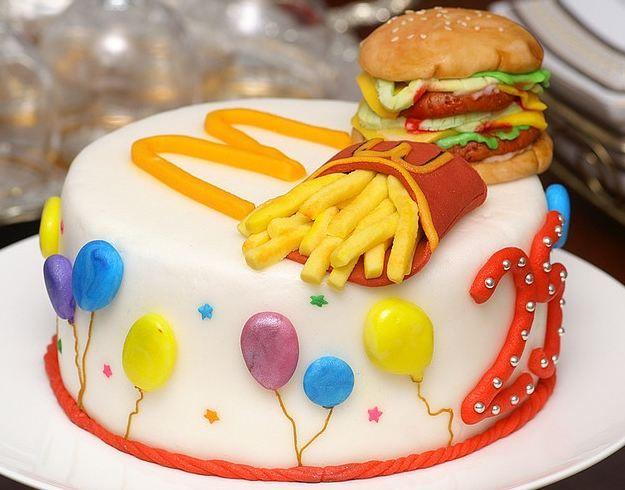 Round white McDonalds theme cake with Big Mac and Fries and