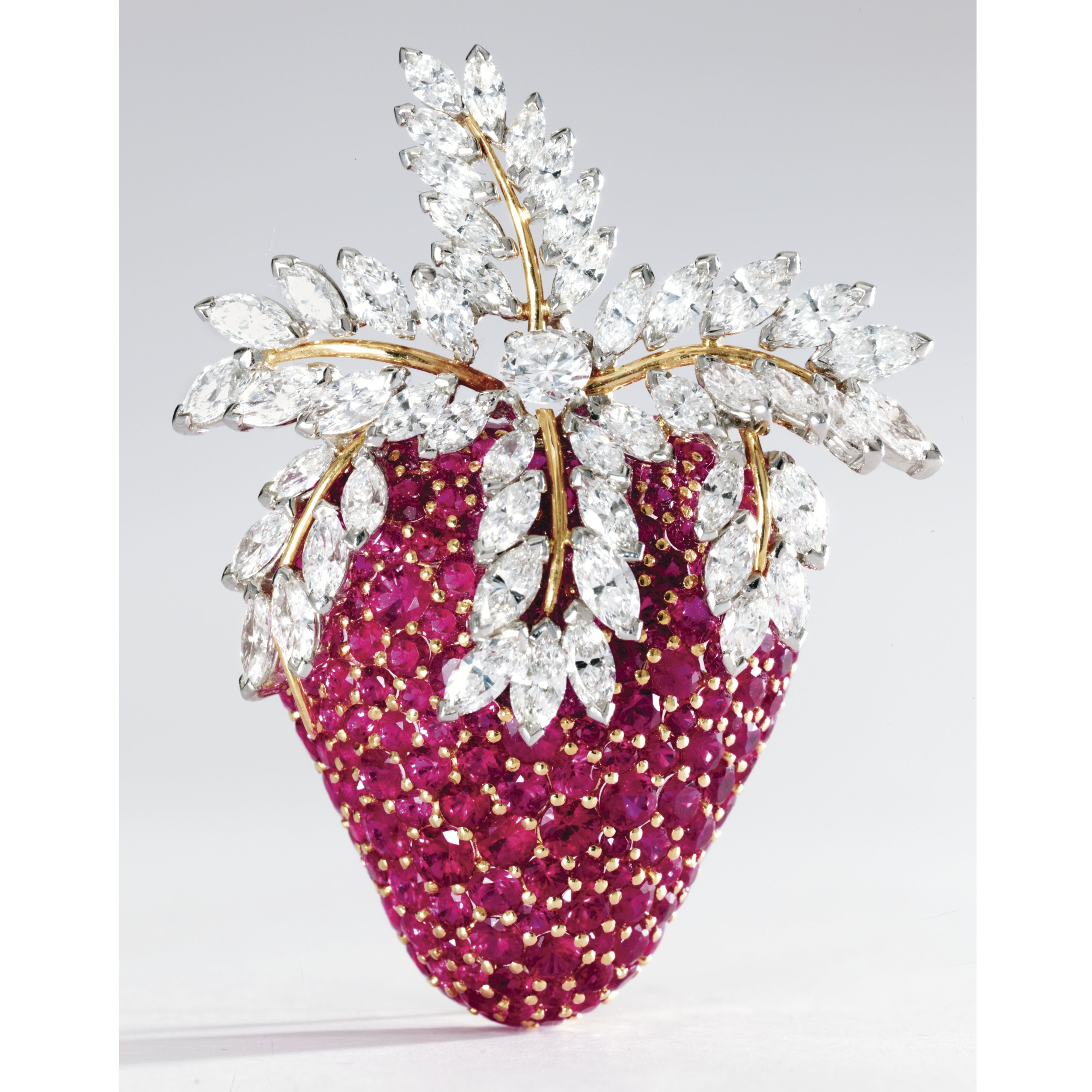 18 KARAT GOLD, PLATINUM, DIAMOND AND RUBY BROOCH, SCHLUMBERGER FOR TIFFANY & CO., FRANCE The strawberry set with round rubies, the leaves set with round and marquise-shaped diamonds weighing approximately 7.00 carats, signed Tiffany & Co., Schlumberger, France, French assay and maker's marks, one ruby missing