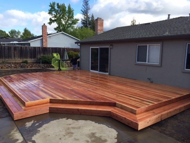 A j fencing installed a beautiful redwood deck with stairs for Redwood deck plans