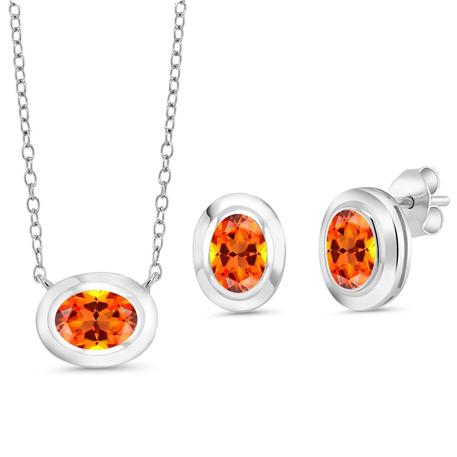 silver pendant earrings set set with oval poppy topaz from