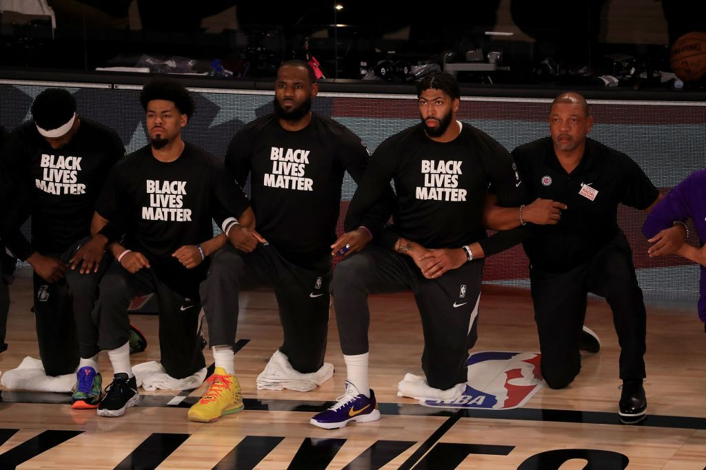 The Nba Set Out To Bring Racial Justice To The Forefront Nba Players Black Lives Matter Shirt Kneeling During National Anthem