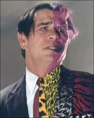 Two-Face, as portrayed by Tommy Lee Jones in the 1995 film Batman Forever. Yes...he has a Phantomy vibe, despite his terrible fashion sense...well it was the 90s!