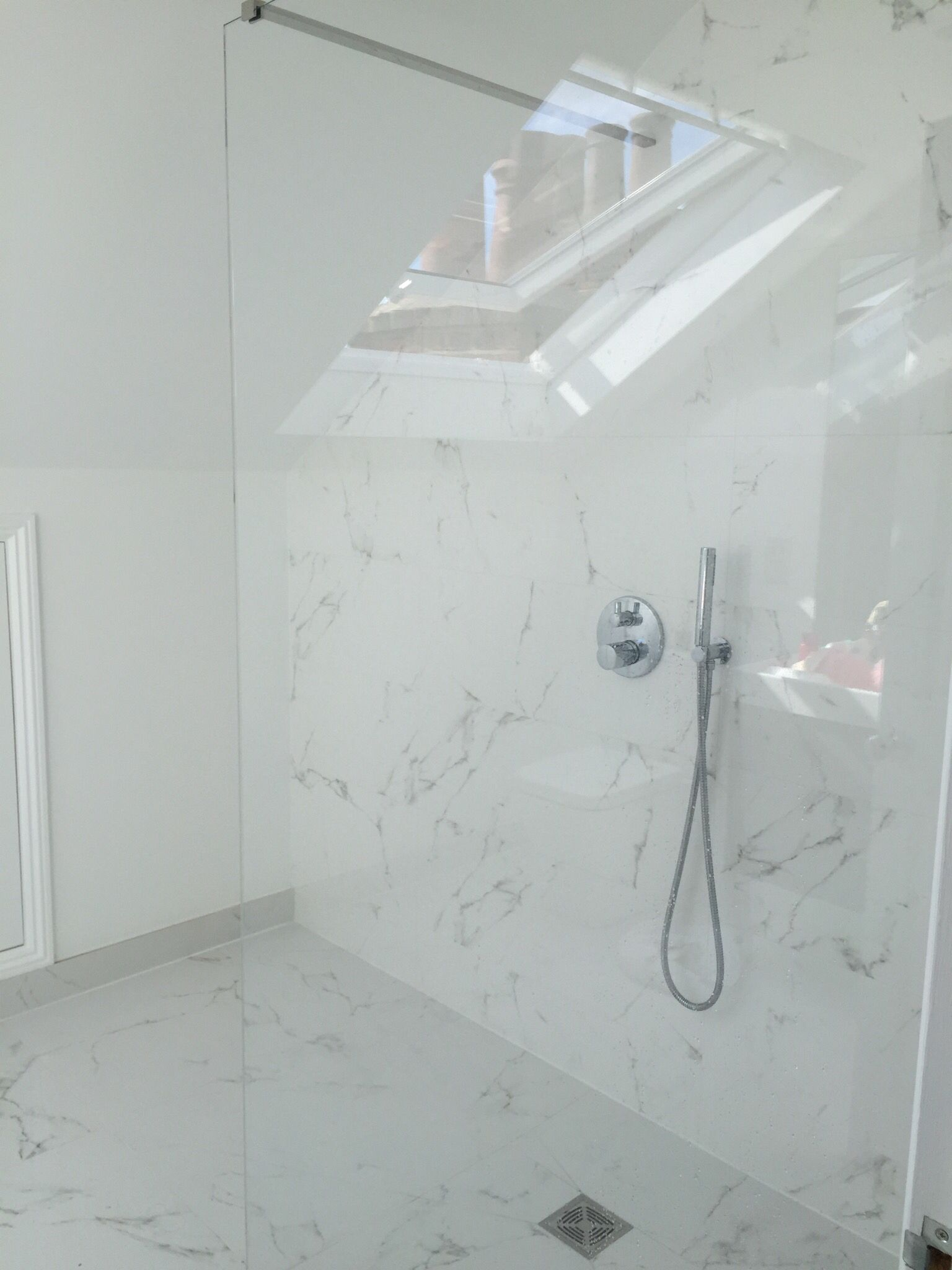 En-suite tiled in Porcelanosa tiling and all fittings supplied by