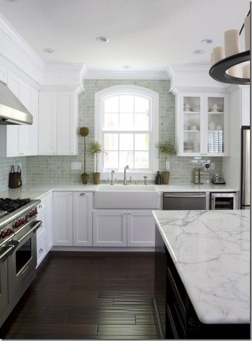 Love everything about this kitchen... Sink, cabinets, floors, backsplash. Love.