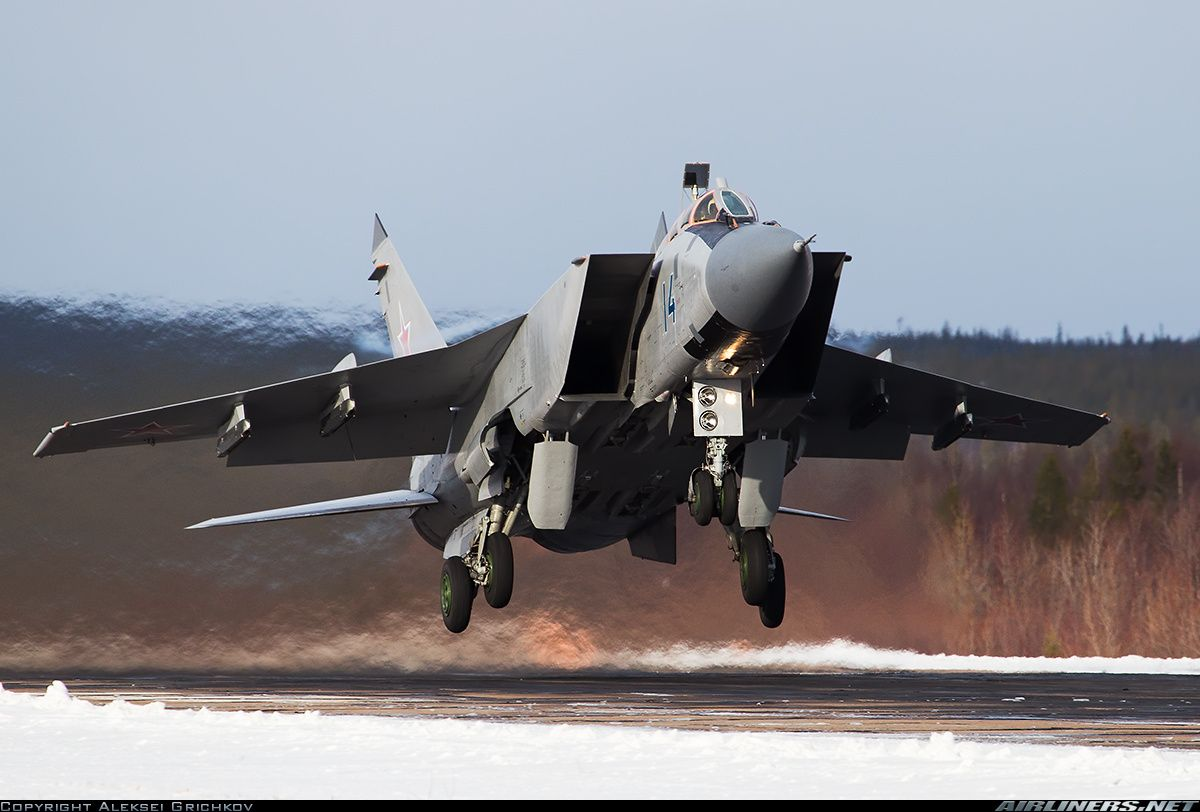 """Mikoyan-Gurevich MiG-31BM The Mikoyan MiG-31 (Russian: Микоян МиГ-31; NATO reporting name: Foxhound) is a supersonic interceptor aircraft developed to replace the MiG-25 """"Foxbat"""". The MiG-31 was designed by the Mikoyan design bureau based on the MiG-25.[4] It is one of the fastest combat jets in the world.[5]"""