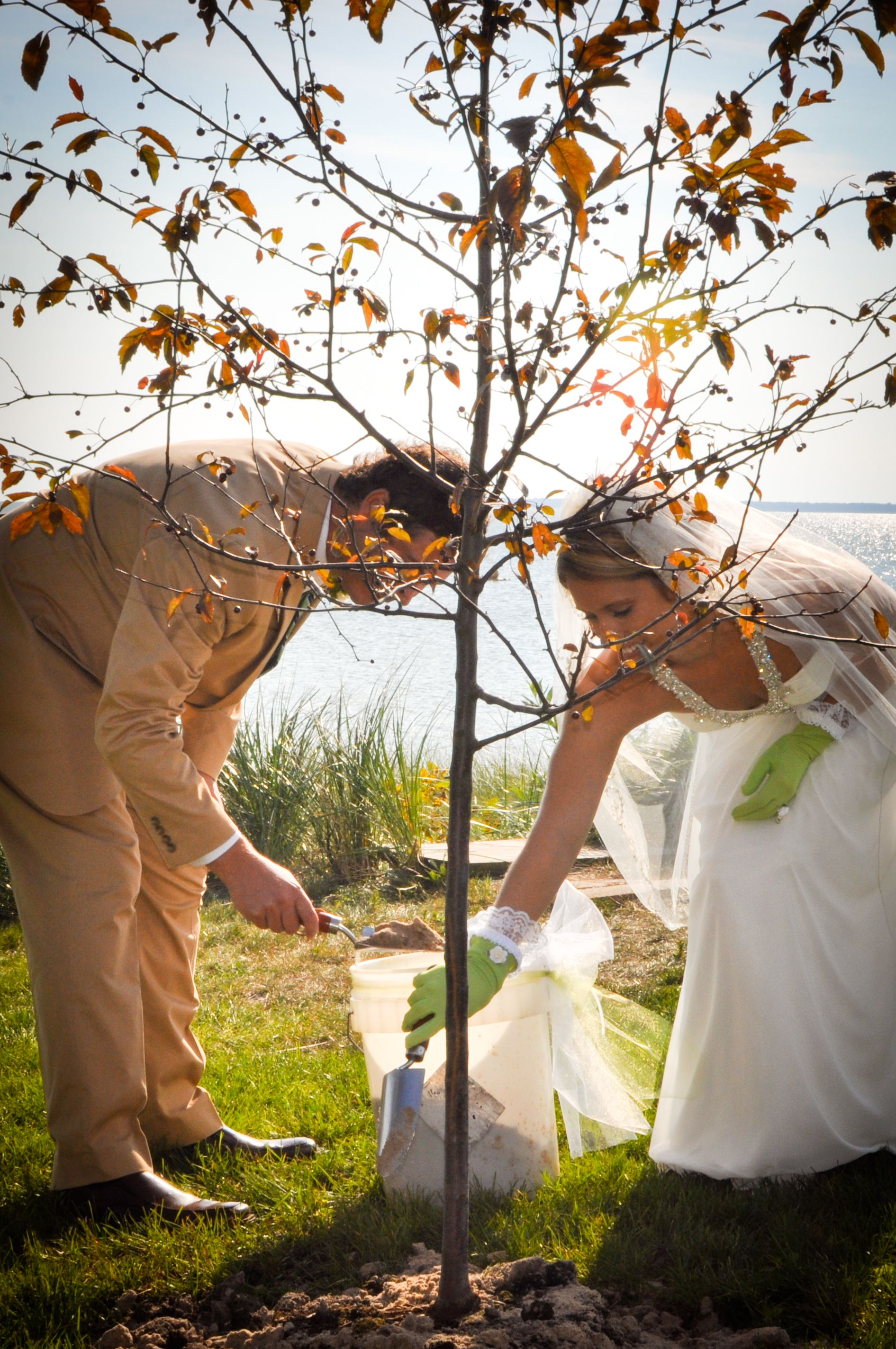 A tree planting ceremony at a wedding. What a great way to