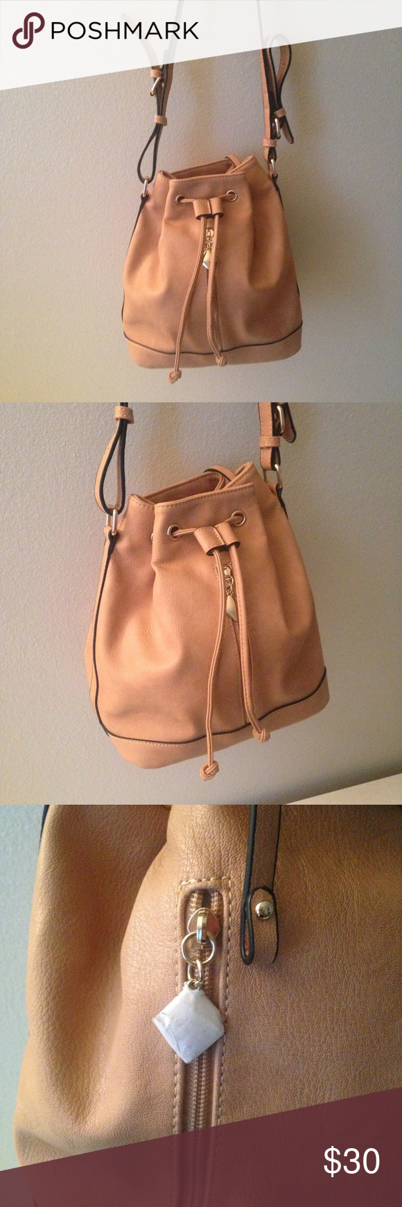 Peach bucket bag Vegan leather. Super cute, adjustable straps with drawstring and magnetic closure. Like new condition. Gold tone hardware. Paper still on zipper Bags Shoulder Bags