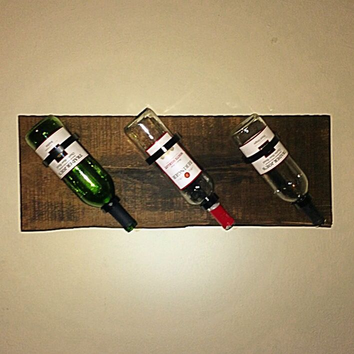 Simple wine rack made from reclaimed barn wood and custom metal brackets.