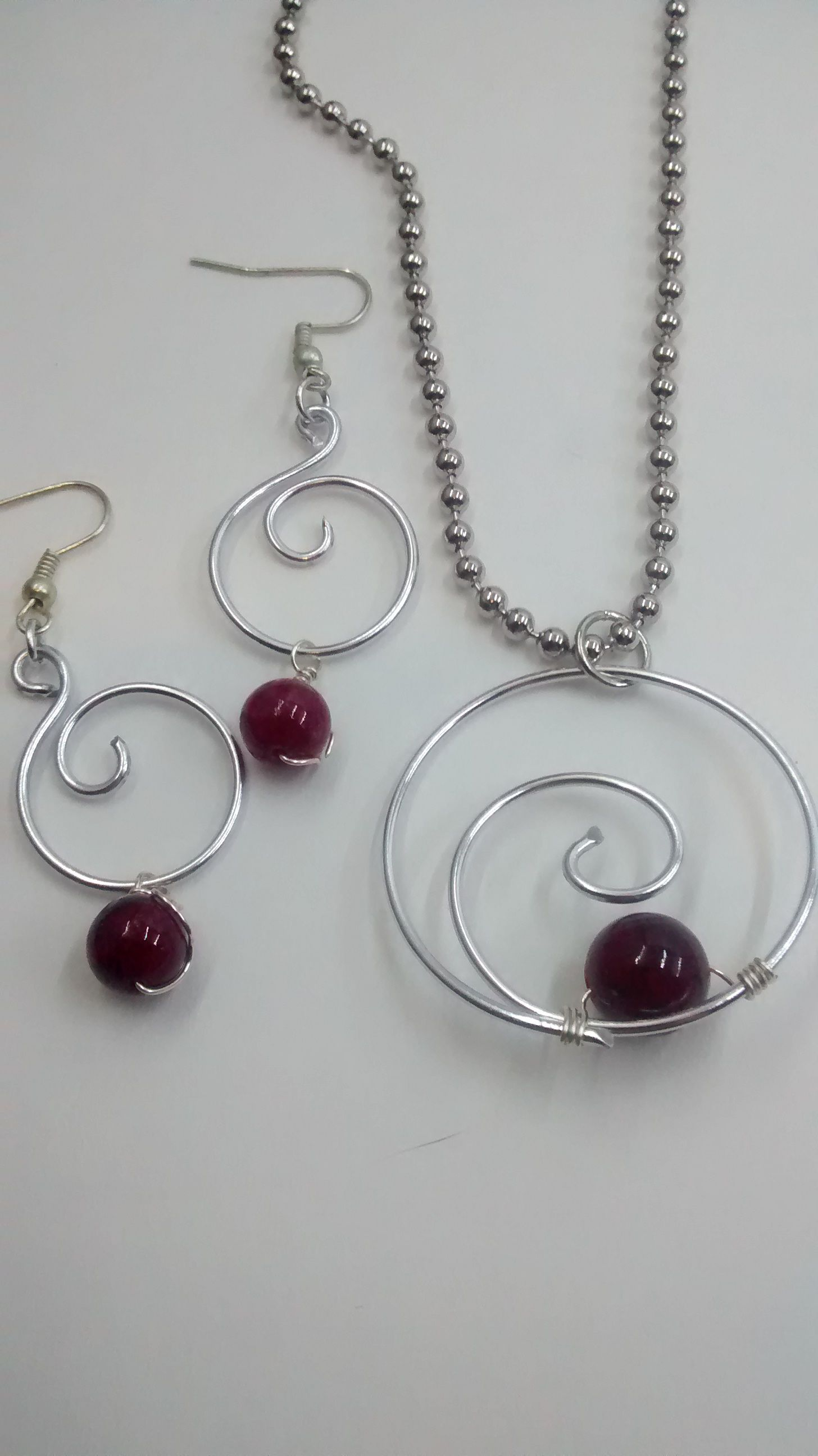 Wire+wrapped+glass+beads+in+a+matching+set+of+necklace+and+earrings ...