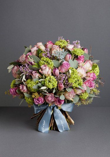 A brilliant explosion of colour, this bouquet is comprised of lilac roses, tulips, guelder, lilac and seasonal foliage.