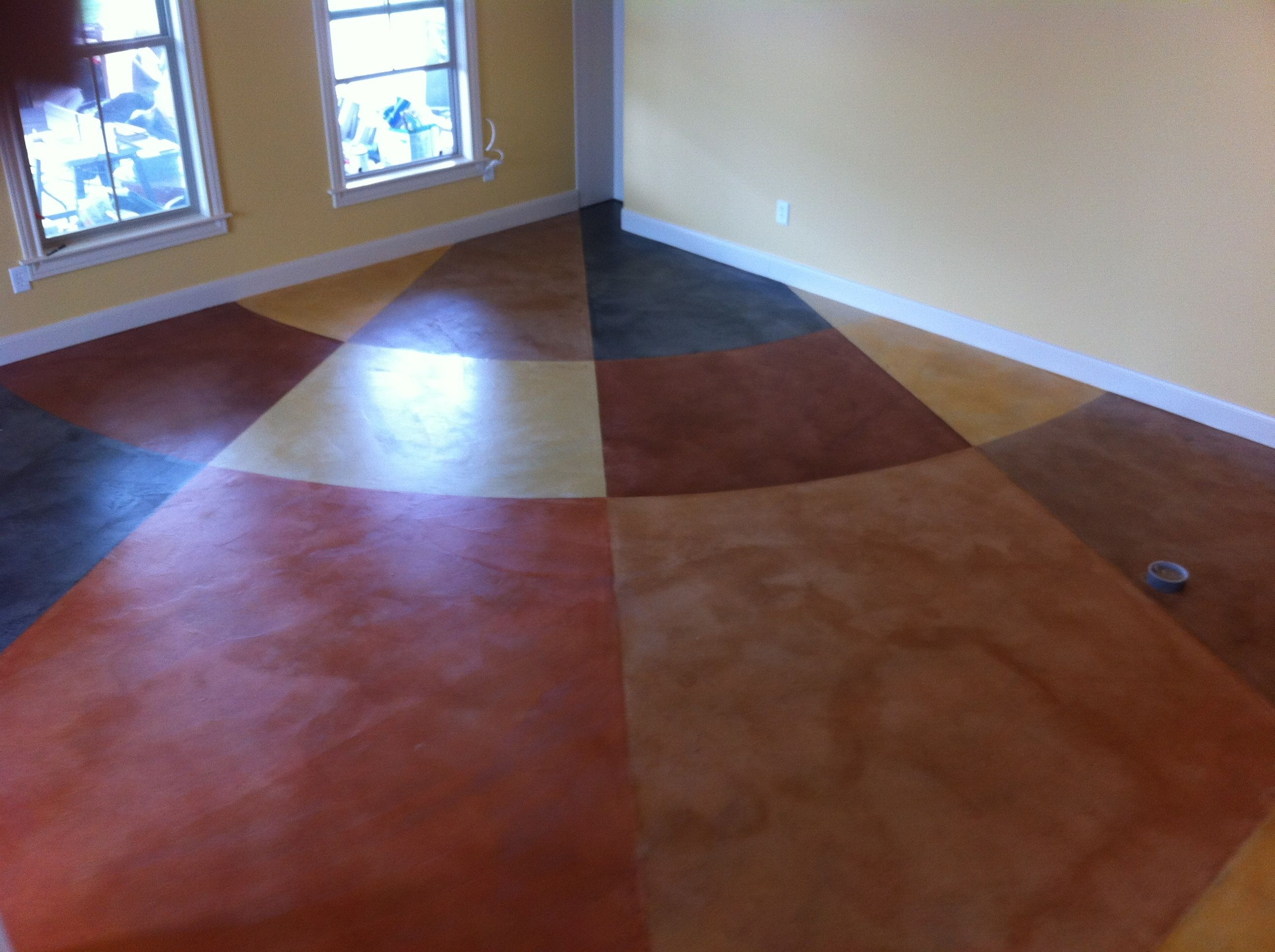 Stained home gym floor in Fulshear Free estimates! Call