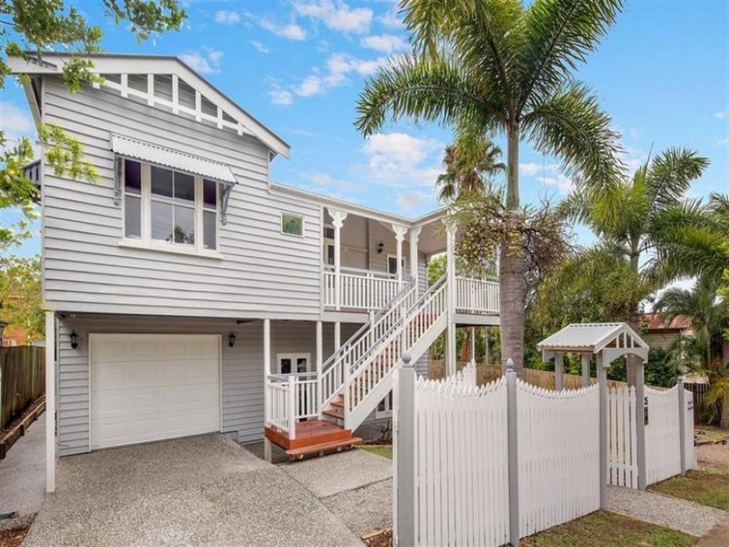 White Panel Garage Door On Grey Raised Queenslander The