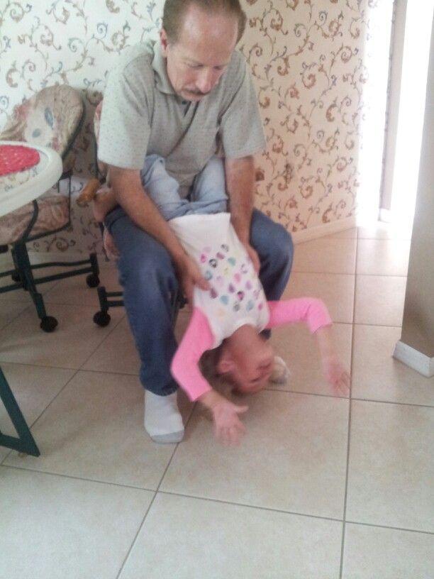 A.J.  playing with grandpa Elliott