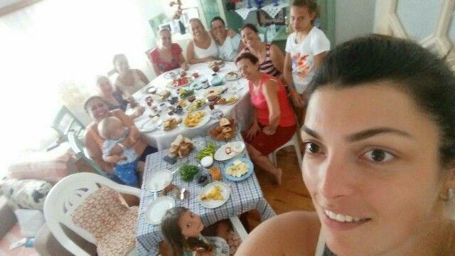 Family breakfast turkey turkish bread honey egg simit turkish bagels jam too many tea milk portugal juice grandmother aunt mom cousien