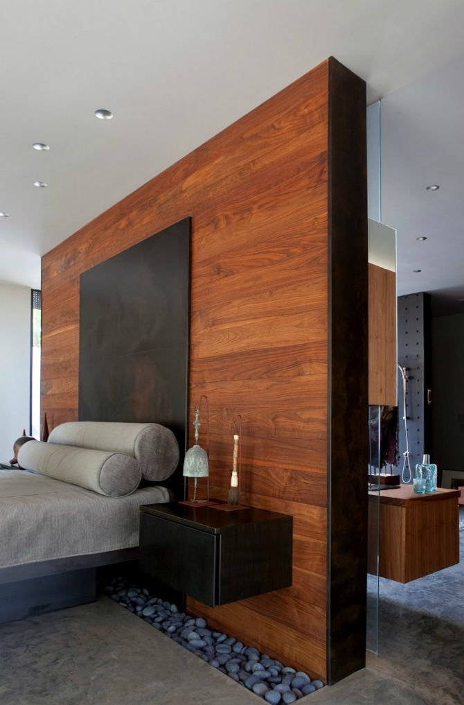 Modern master bedroom with wooden wall   This is the perfect idea for  masculine bedroom interiors
