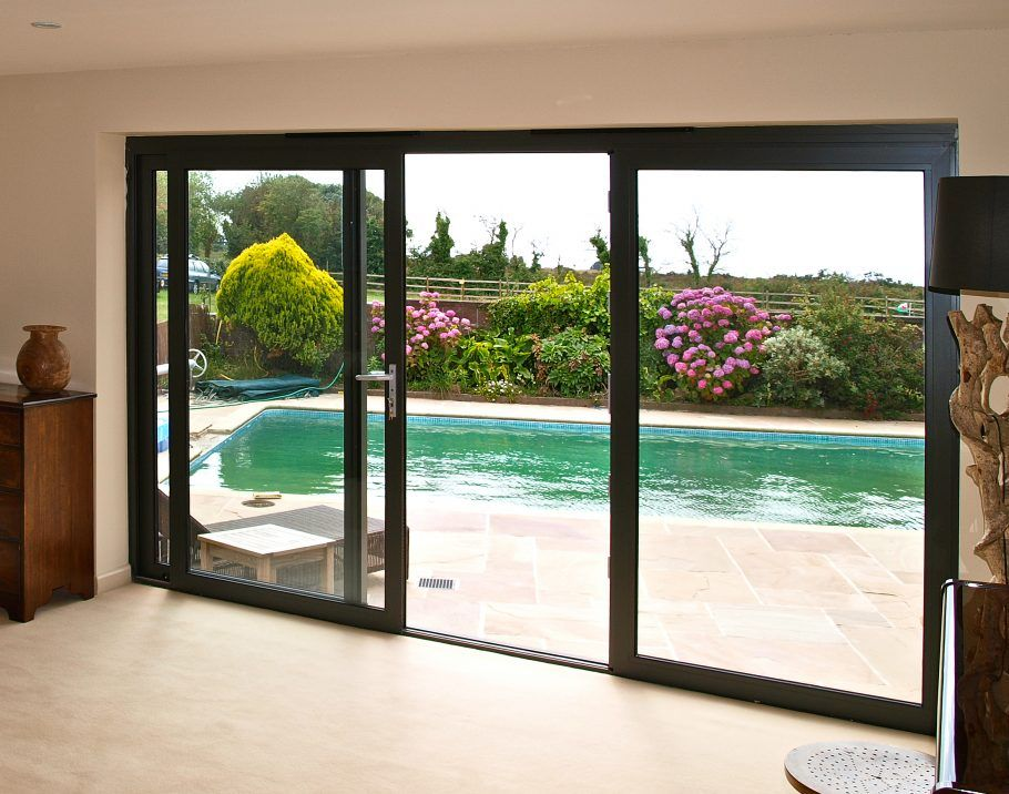 Large Double Sliding Patio Door With Black Frame Facing Garden Pool Fabulous Double Sliding Patio Door Glass Doors Patio Sliding Glass Doors Patio Patio Doors