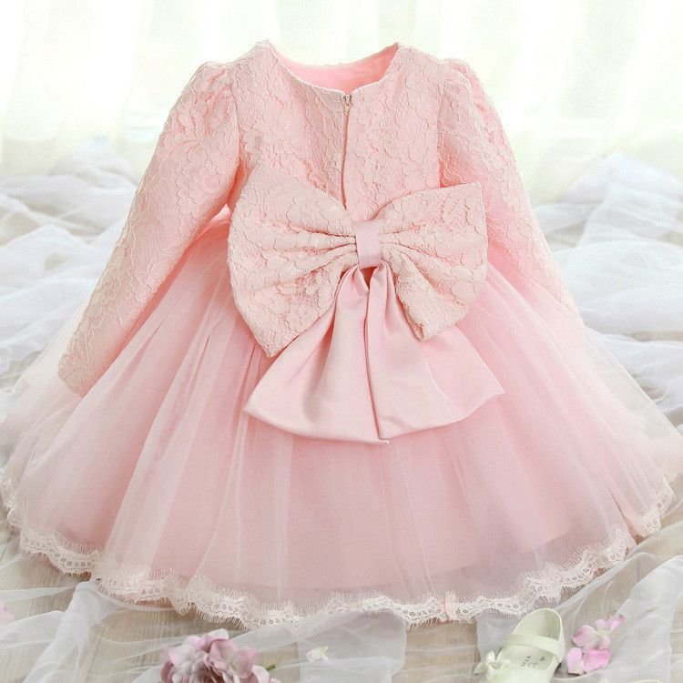 Lovely lace dress in pretty pink! Bow in back. Lace trim on hem ...