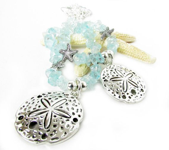 These Sand Dollar Curtain Tiebacks Have A Silver Pendant And Gorgeous Light Blue Glass