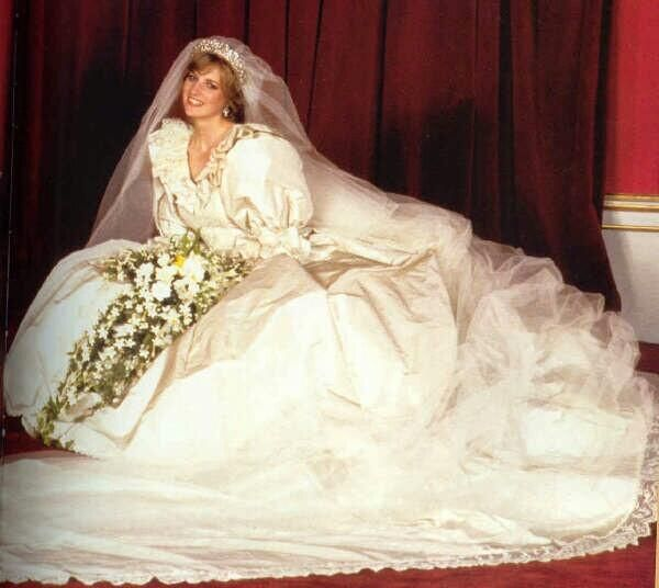 The wedding dress that forever will be etched in bridal history, Princess Diana\s gown was made of ivory silk taffeta and antique lace. Description from pinterest.com. I searched for this on bing.com/images