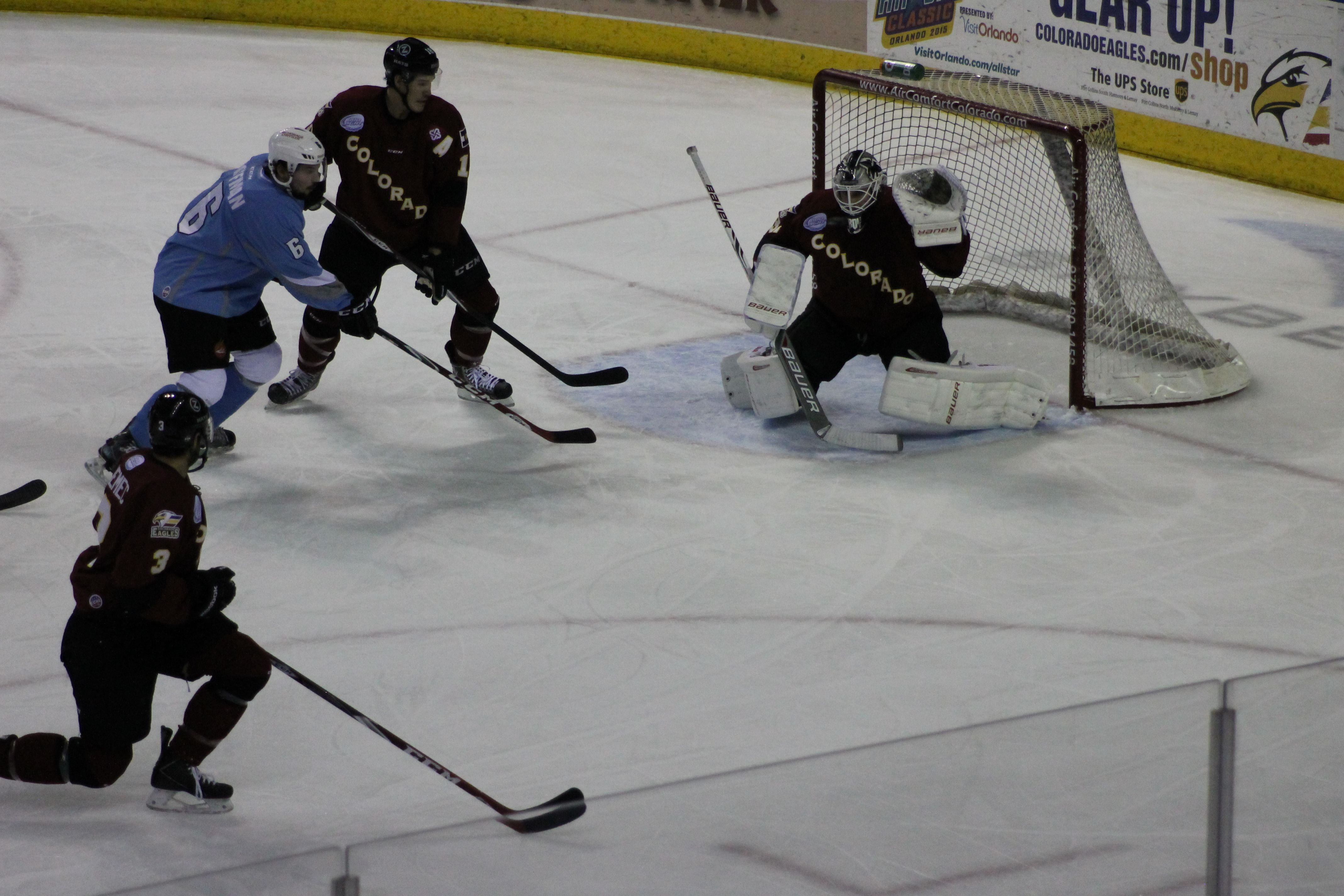 Its in the glove  Great stop by Eagles New Goalie #31 Troy Redmann.  Great Game