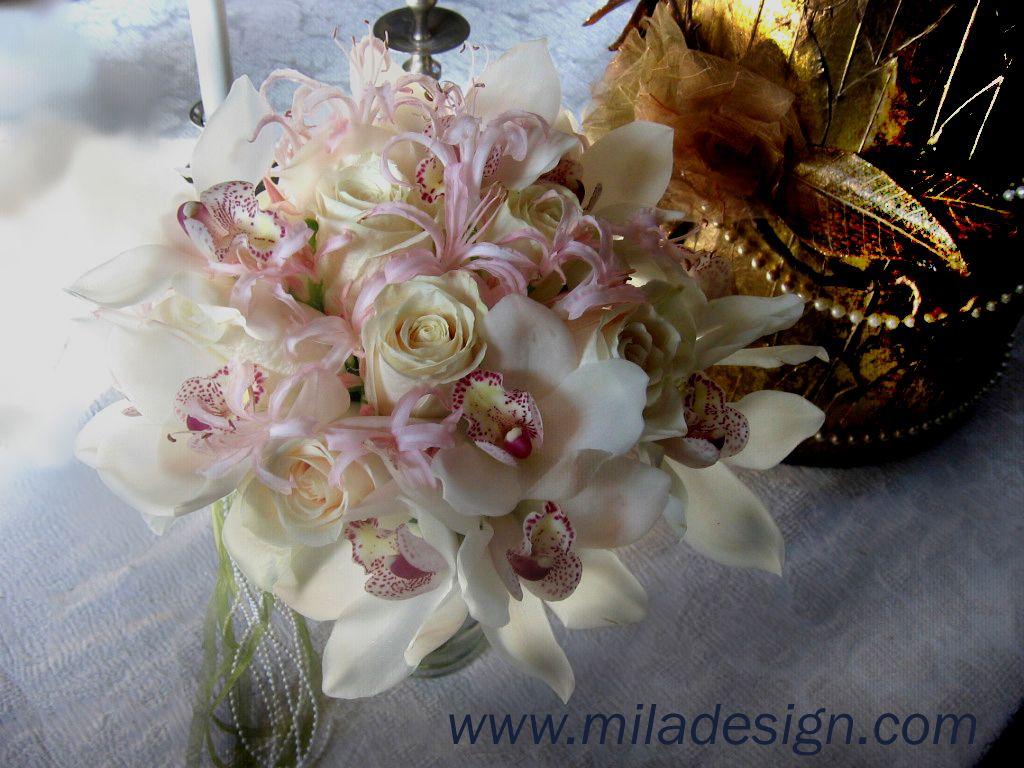Bridal bouquet white roses cymbidium orchids pink