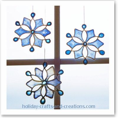 Stain glass look ornaments made from string & glue