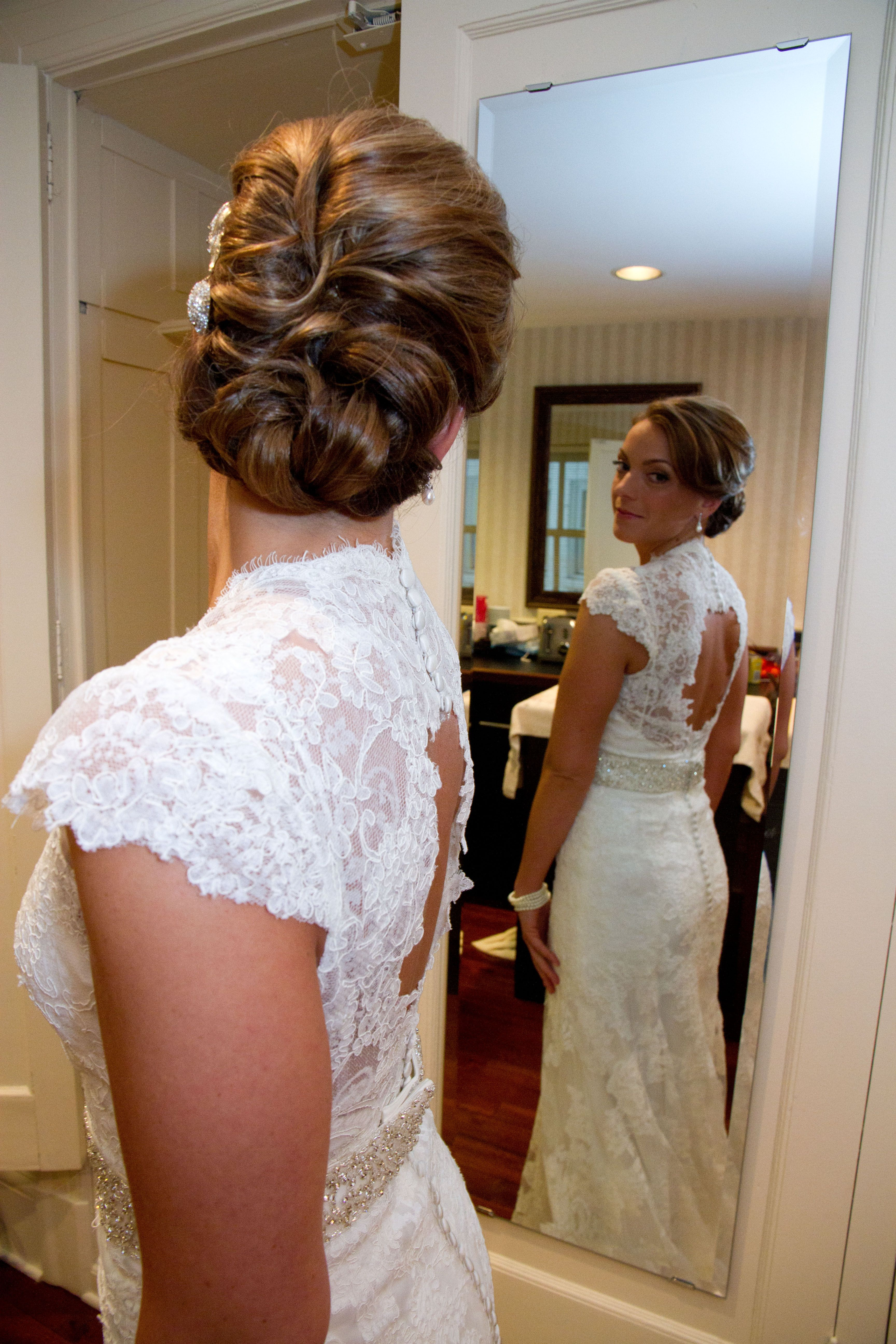 we love this brides hair! and dress :) photo by angeli