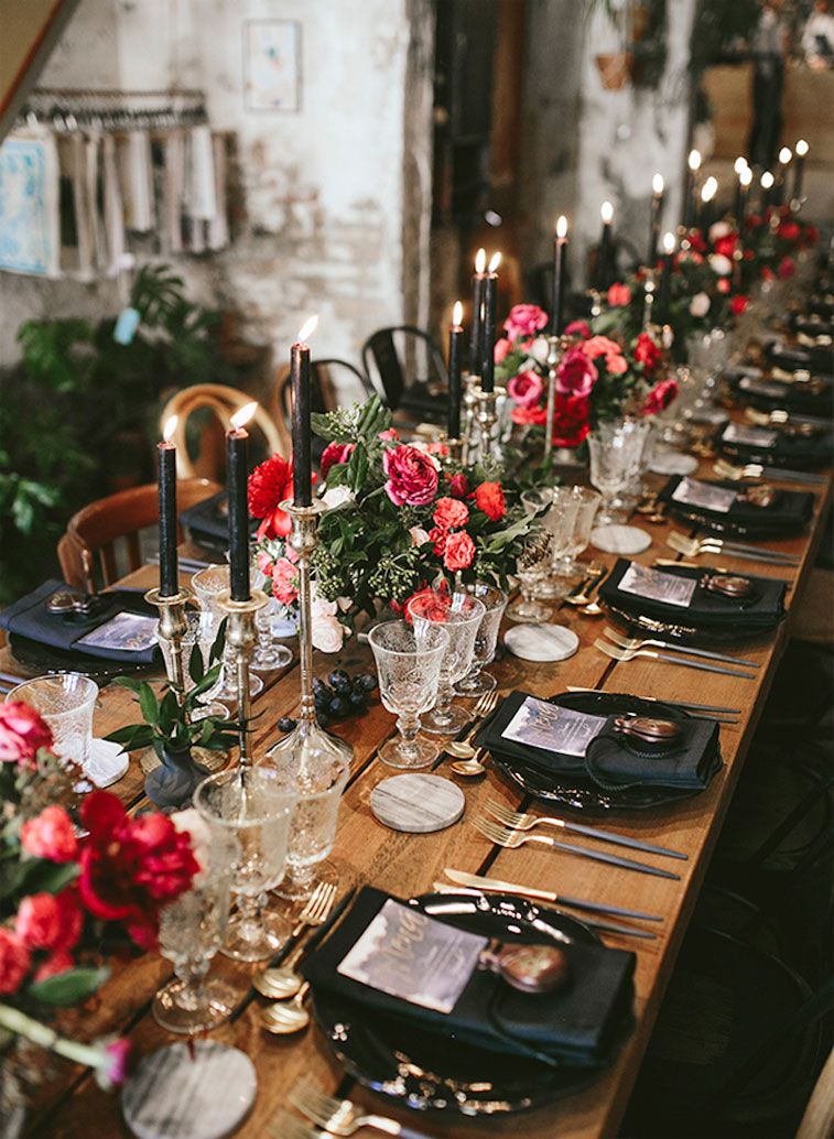 Moody wedding table decor with bright pink and red wedding centerpieces , wedding table decor