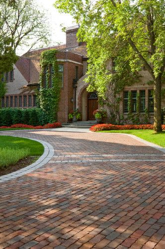 The orientation of the entrance was improved to better align automobile traffic. The new permeable driveway is built of recycled clay bricks placed on gravel.
