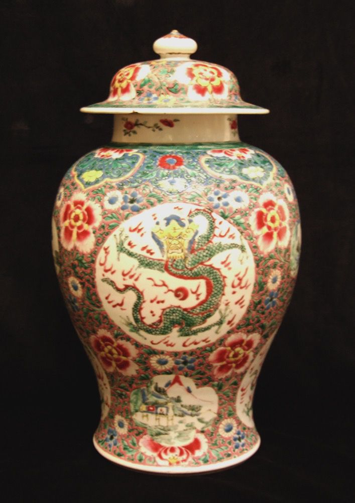A Yongzheng (1723 - 1735) Famille Rose Baluster Shaped Jar and Cover. Richly Decorated on a Pink Ground with Large Circular Reserves of Outstretched Dragons and Lobed Reserves of Landscapes, the Pink Ground Colour is Painted with Three Types of Flowering Scrolling Plants. The Ruyi Shaped Collar with a Blue Ground and Decorated with Flowers.