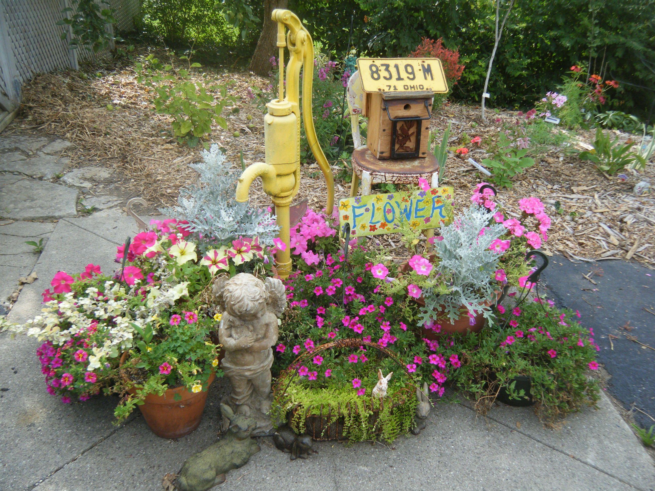 Flower Garden Around Old Water Pump Garden Containers Flower Garden Old Water Pumps