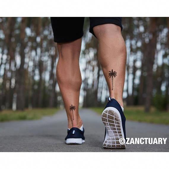Tattoos On Back Dumbbell Tattoosonback Tree Tattoo Men Palm Tree Tattoo Tree Tattoo Ankle