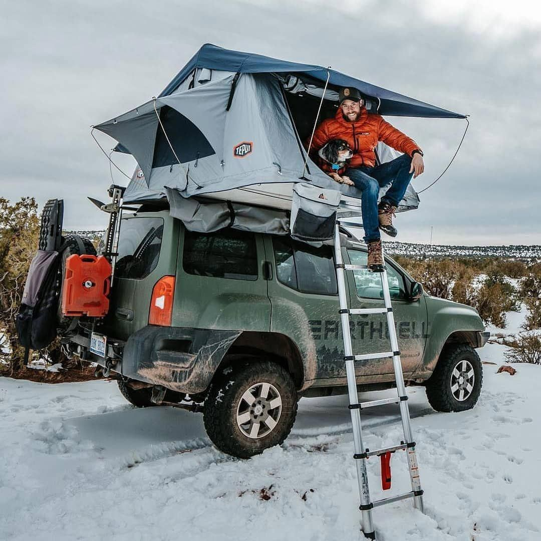 Rooftop camping in the beautiful outdoors Tepui tent