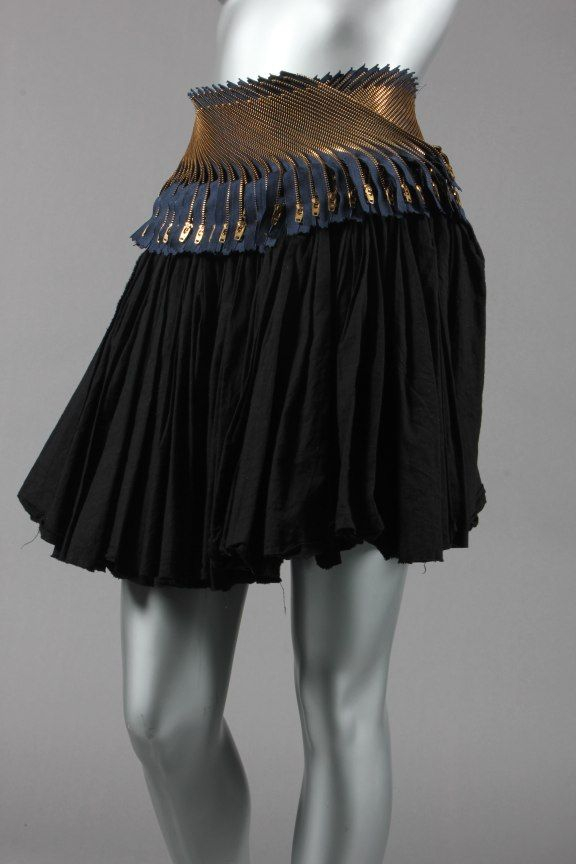 a2ad55625c Junya Watanabe/Comme des Garcons `zipper' ra-ra skirt, 2004, labelled, of  black cotton with raw hem, the waistband adorned with multi-layers of zips  which ...